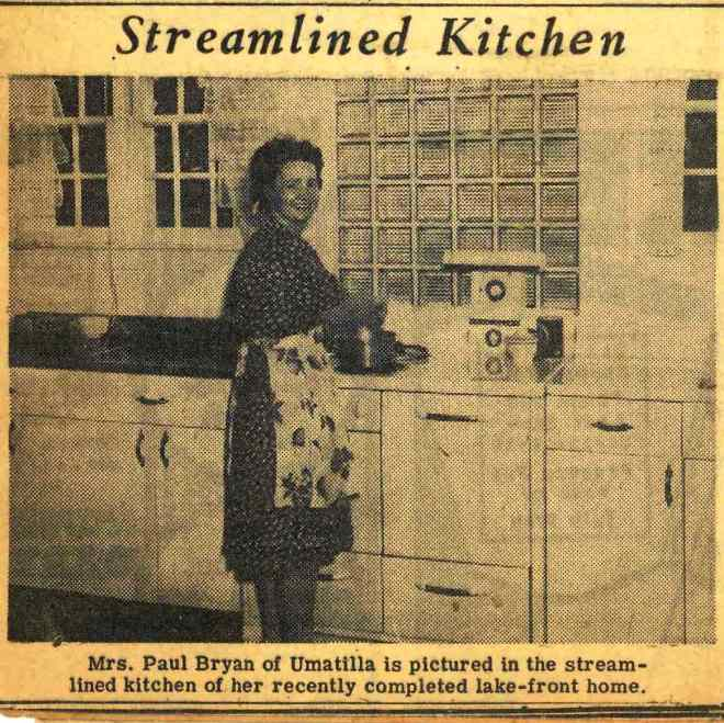 My great-aunt in her model modern kitchen.